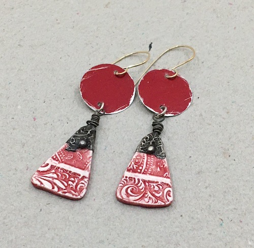 Earrings with red tin disks, and red and white stamped ceramic diamonds with stamped metal at the top on sterling ear wires.