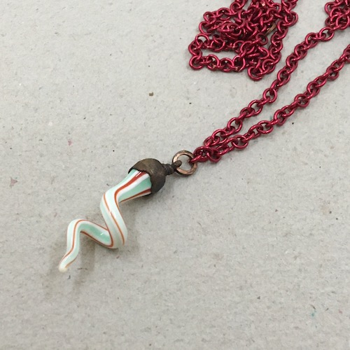 Same red, green, white siwrly lampwork necklace as above.