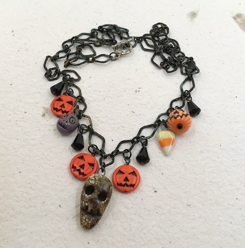 Another shot of the Halloween charm necklace.