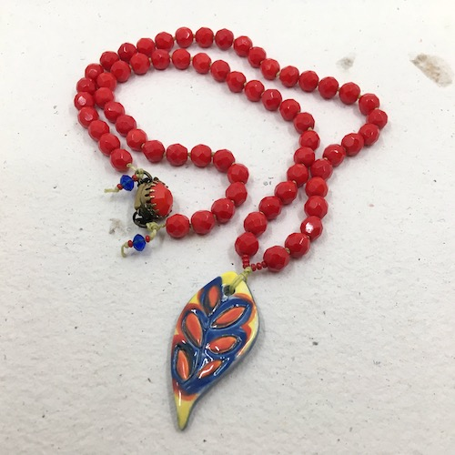 Same primary color leaf and red bead necklace as in the previous picture.