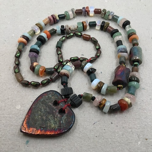 The same raku and gemstone necklace as in the last picture.