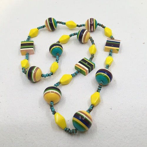 The same striped resin necklace as in the photo above.