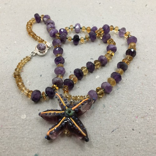 Same starfish, citrine and amethyst necklace as above.