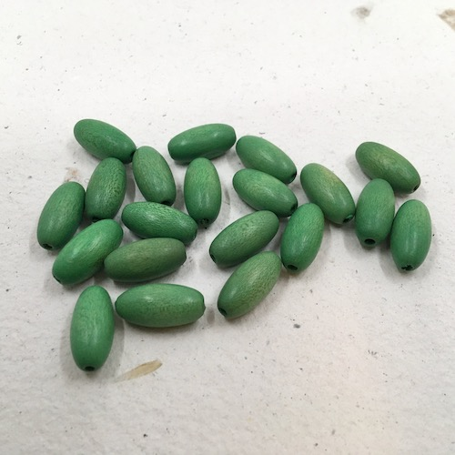 Bright green oval wooden tube beads.