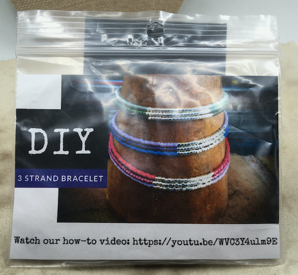 Bracelet kit in a bag that says DIY and shows a YouTube link to the tutorial. It is a three strand seed bead bracelet with three different colors on each bracelet and silver in the middle. The YouTube link shown is https://youtu.be/WVC3Y4ulm9E