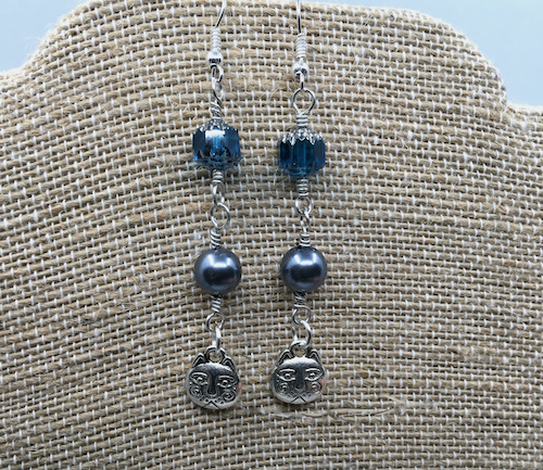 Earrings consisting of three links - blue cathedral beads, blue glass pearls and silver cat charms.