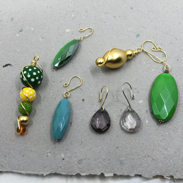 A variety of plastic beads made into ornaments with wire hangers.