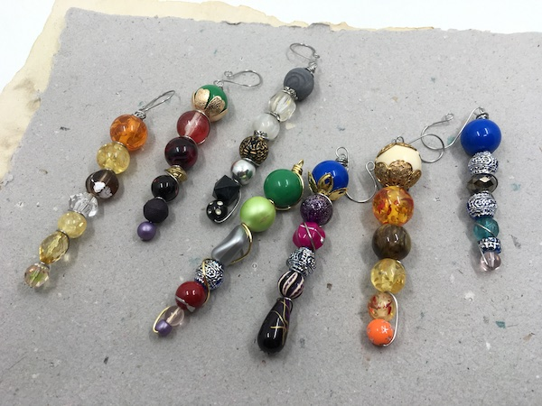 A large variety of colors of beads in somewhat graduated lines to look a little like icicles.