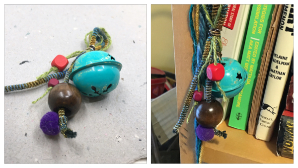Side-by-side pictures of finished kit of fibers, beads and bell, now painted verdigris, as an ornament, one laying down and one hanging.