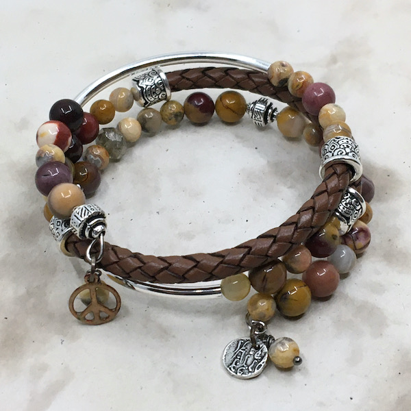 Wrap bracelet of brown braided leather, silver metal and round gemstones in mookaite, crazy lace agate and small charms.