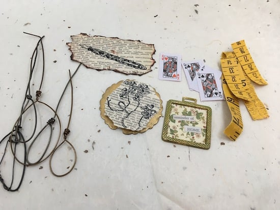 Various wire, paper, mixed media and metal components.