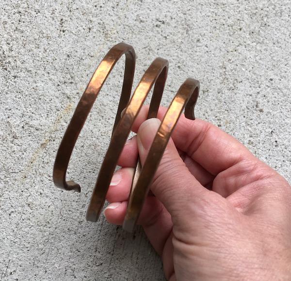 Triple wound copper bracelet.