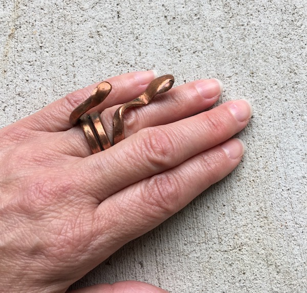 Copper ring shaped like a snake.
